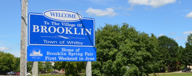 Welcome to the Village of Brooklin Sign in Whitby by Real Estate Agents on Team Downey